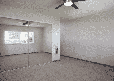 empty-bedroom-with-mirror-ceiling fan